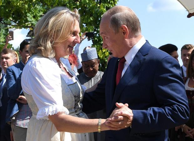 Austria's Foreign Minister Kneissl dances with Russia's President Putin at her wedding in Gamlitz.