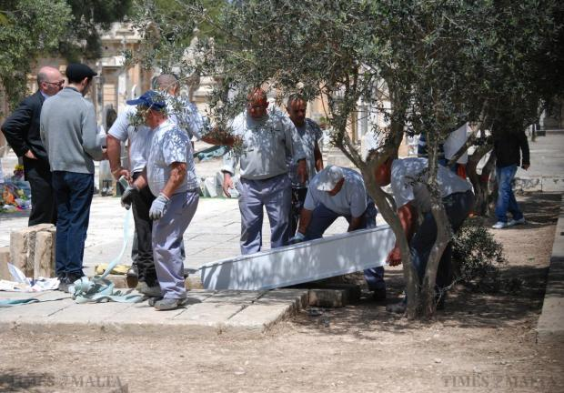 The coffin of a teenage migrant is lowered into a grave at the Addolarata cemetery on April 23. Photo: Mark Zammit Cordina