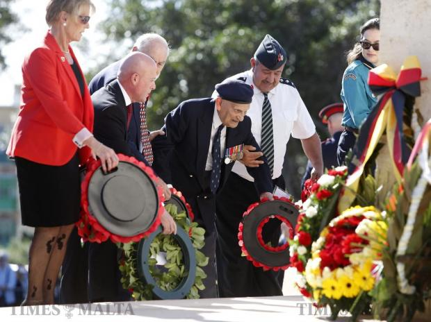 People help a British military veteran lay a wreath on the war memorial cenotaph during the Remembrance Sunday ceremony in Floriana on November 13. Photo: Darrin Zammit Lupi