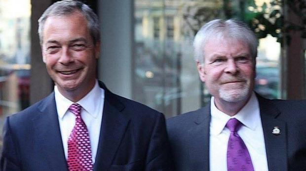Stephen Searle (right), then Ukip county councillor, seen together with Nigel Farage in 2013. Photo: Facebook.