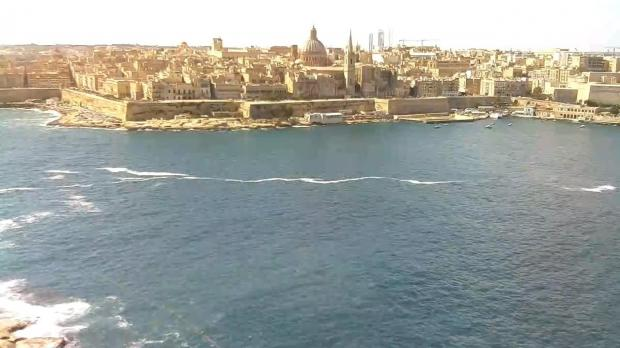 An online webcam trained on Valletta's Marsamxett side also showed a ribbon of foam. Screenshot: Skyline Webcams