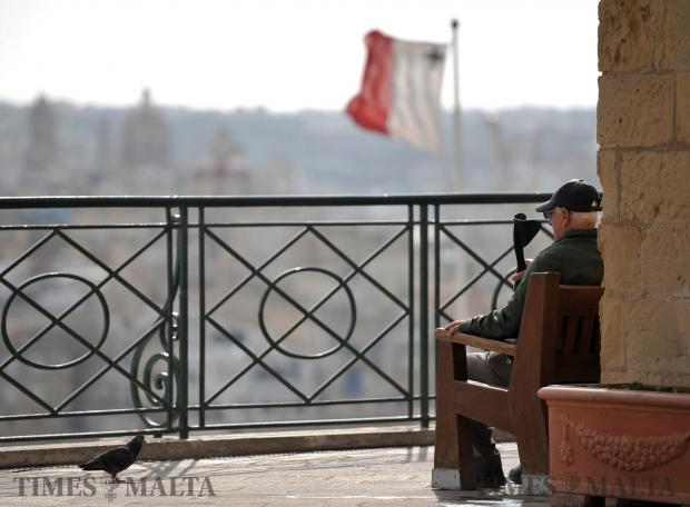 A man enjoys the view of Grand Harbour from the Upper Barrakka Garden on February 2. Photo: Chris Sant Fournier