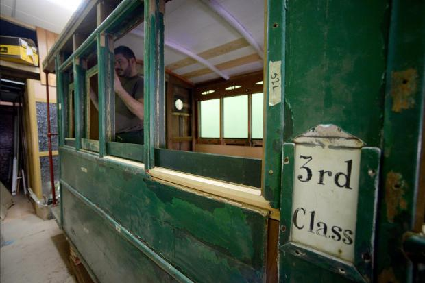 Restorer, Renald Bezzina works on a window of an old train carriage in his workshop in Tarxien on April 6. The third-class carriage had been left neglected at the old B'kara station before being removed over a year ago. Photo: Matthew Mirabelli