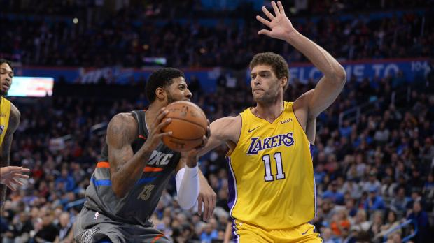 Oklahoma City Thunder forward Paul George (13) drives to the basket in front of Los Angeles Lakers center Brook Lopez (11) during the fourth quarter at Chesapeake Energy Arena. Photo Credit: Mark D. Smith-USA TODAY Sports