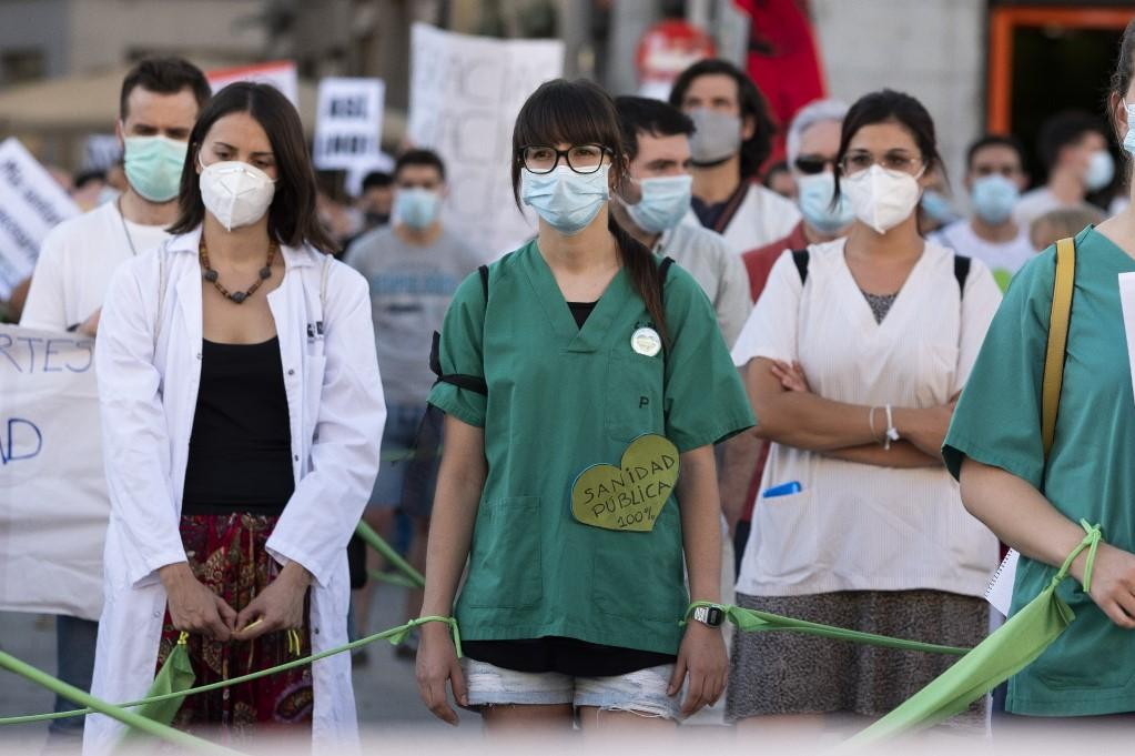 Nurses demonstrators for a free and universal health system on June 29, 2020 in Madrid, Spain. Spain's health care workers had to work under pressure during the Coronavirus (COVID-19) pandemic while the health care system was overloaded and unable to function efficient