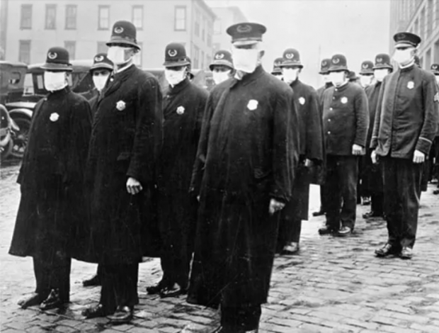 Policemen wearing masks provided by the American Red Cross in Seattle, 1918. Wikimedia Commons