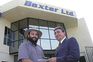 Jean-Paul Mifsud (left), chairman YMCA, receiving the donation from Sergio Vella, director of manufacturing, Baxter Malta.