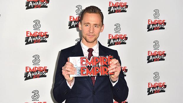 Tom Hiddleston with his Empire hero award.