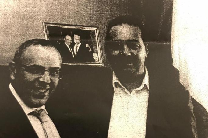 Keith Schembri and Melvin Theuma smile in this photo taken inside Schembri's office at Castille.
