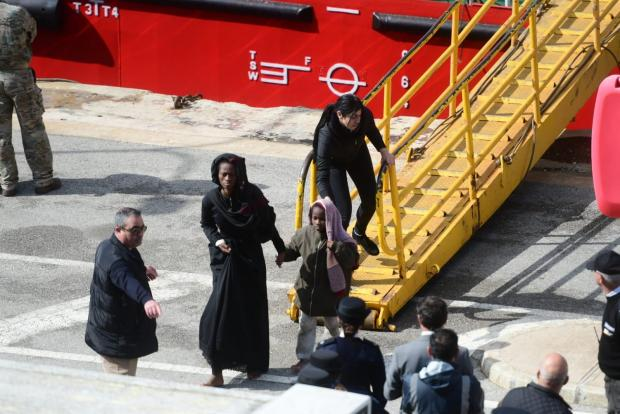 Two of the migrants disembarking on Thursday. Photo: Jonathan Borg