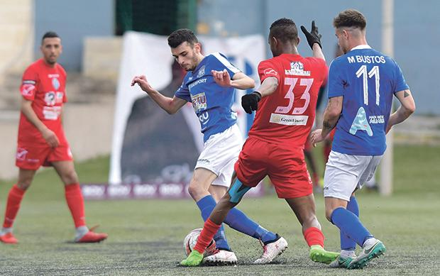 Clive Gauci (left) of Sirens protects the ball from his Gudja United opponent. Photo: Matthew Mirabelli