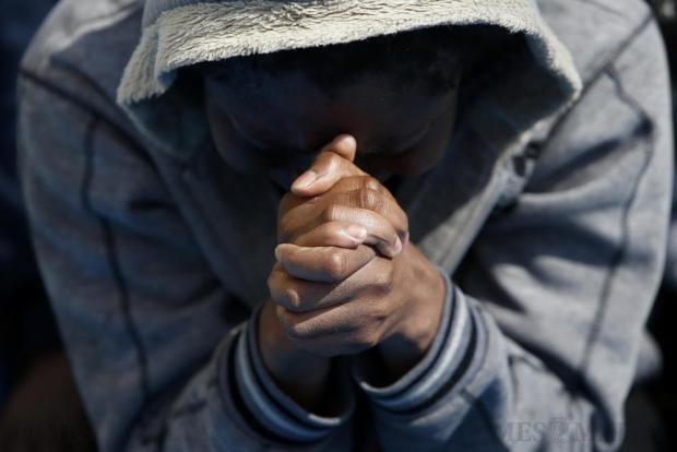 A migrant prays on the Migrant Offshore Aid Station (MOAS) ship Topaz Responder after being rescued around 20 nautical miles off the coast of Libya on June 23. Some 5,000 migrants from over 40 boats were rescued that day, according to the Italian Coast Guard. Photo: Darrin Zammit Lupi