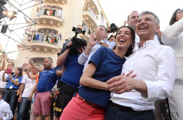 Simon Busuttil accompanied by his partner Kristina look out into the crowd during a mass meeting in Sliema on May 28. Photo: Matthew Mirabelli
