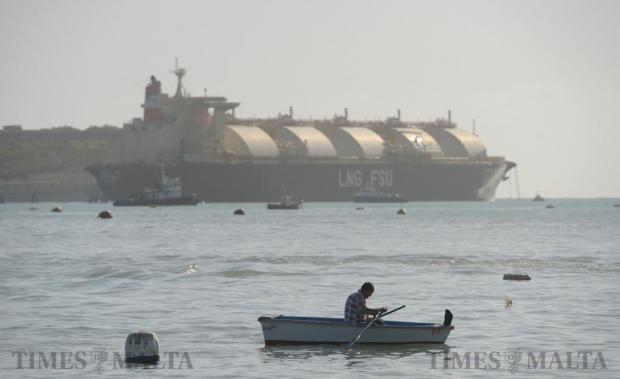 A fisherman rows his boat to the shore in Marsaxlokk on December 21. Photo: Matthew Mirabelli
