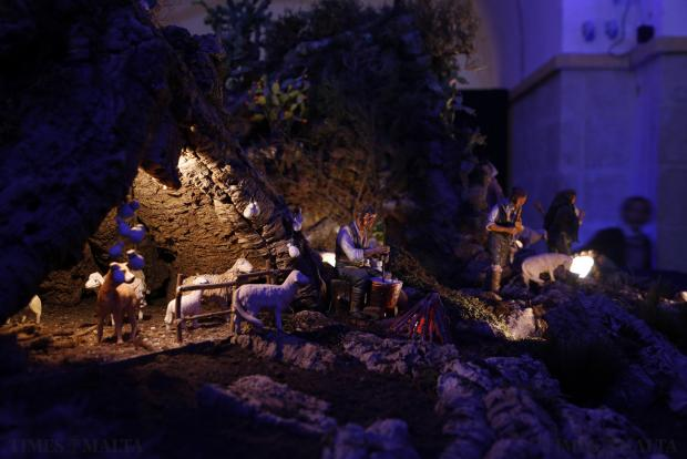 "Schoolchildren look at a 40 square metre mechanised crib, dubbed by experts as the ""most famous in the world"", at a nativity museum at the crypt of St Augustine's Church in Valletta on December 16. The Caltagirone Crib has featured at the opening of the European Parliament in Strasbourg, the Notre Dame Cathedral in Paris and in other European cities. Photo: Darrin Zammit Lupi"