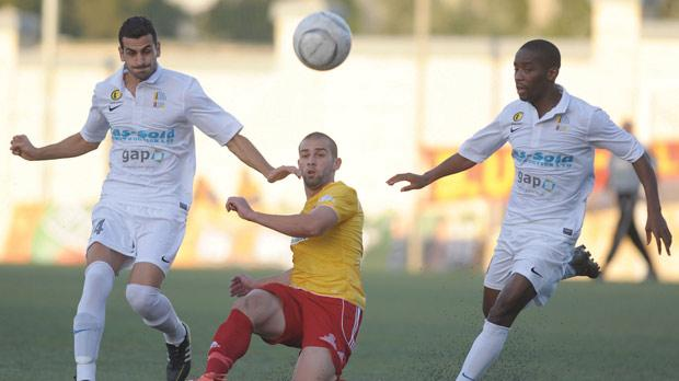 Sheer grit... Birkirkara's Joseph Zerafa (centre) makes a clearance during the Mosta game. Photo: Matthew Mirabelli
