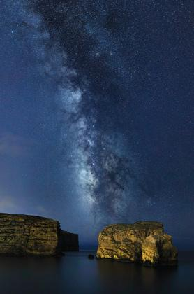 A breathtaking view of the Milky Way dwarfing il-Ġebla tal-Ġeneral (Fungus Rock) from Dwejra, Gozo. This is an image from the album StarScapes of Malta, a series of landscape astrophotography by Gilbert Vancell www.fb.com/GilbertVancell.