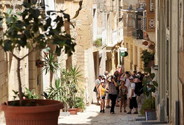Tourists are taken around the Vittoriosa alleyways on July 27. Photo: Chris Sant Fournier