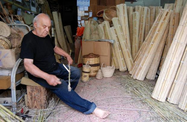 Cane weaver John Mifsud cuts some sticks before he starts to make a basket at his workshop in Hamrun on 21 May. Photo: Mark Zammit Cordina.