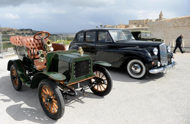 A man walks past a selection of classic cars on the outskirts of Mdina on March 27. Photo: Matthew Mirabelli