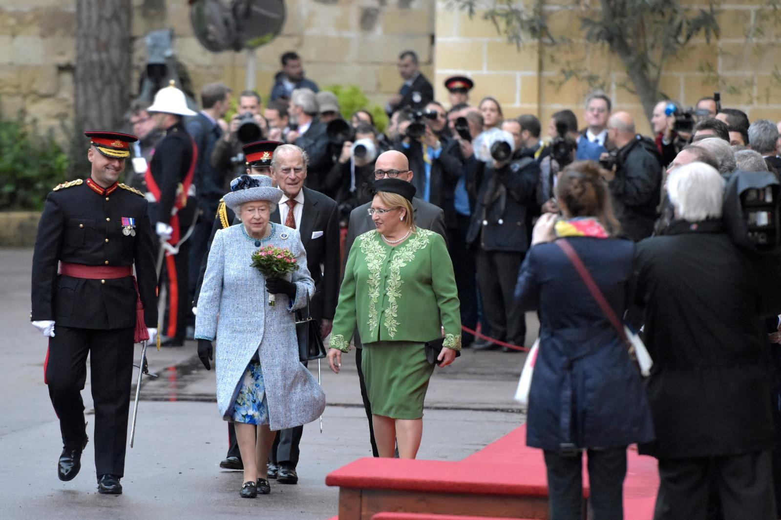 Prince Philip walks behind Queen Elizabeth II and Maltese president Marie-Louise Coleiro Preca during a visit in November 2015. Photo: Matthew Mirabelli
