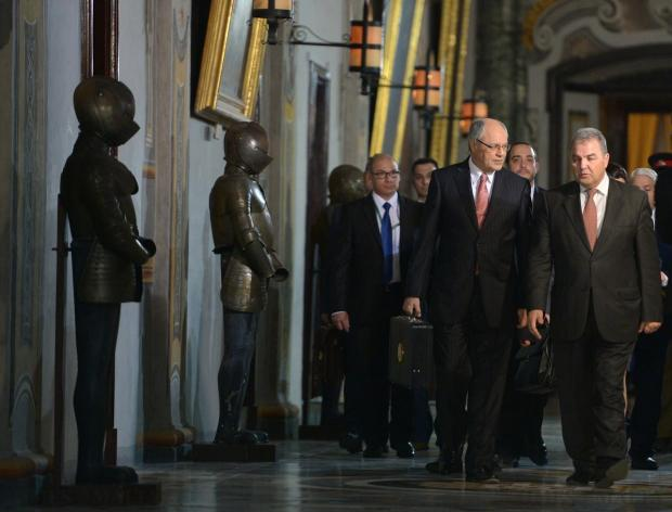 Finance Minister Edward Scicluna and speaker Anglu Farrugia make their way through the Palace in Valletta towards Parliament before presenting the budget on November 17. Photo: Matthew Mirabelli