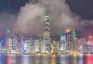 Hong Kong's skyline at night. The city is a major tourist attraction with more than 30 million visitors every year. The Symphony of Lights is a daily light and sound show.