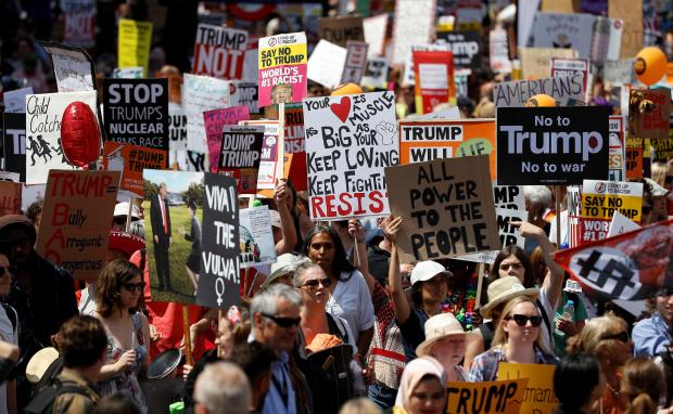 Demonstrators protest against the visit of US President Donald Trump, in central London.