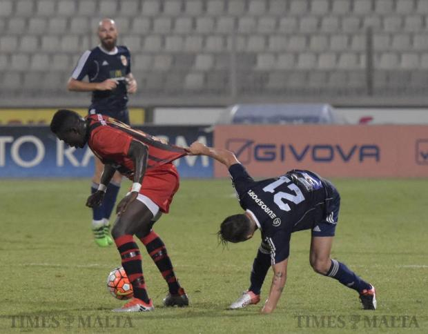 Birkirkara's Ryan Scicluna attempts to stop Hamrun Spartans forward Haruna Garba by pulling his shirt during their Premier League football match at the National Stadium in Ta' Qali on September 11. Photo: Mark Zammit Cordina