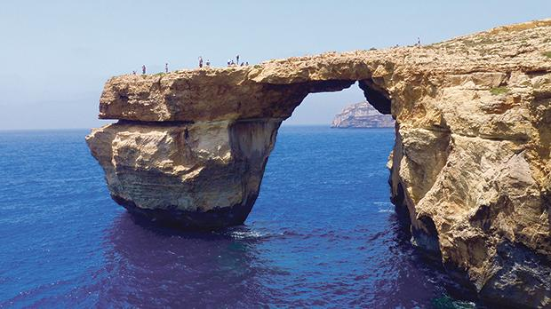 In this stock picture, visitors can be seen standing on the Azure Window just days before its collapse. Photo: Steve Zammit Lupi