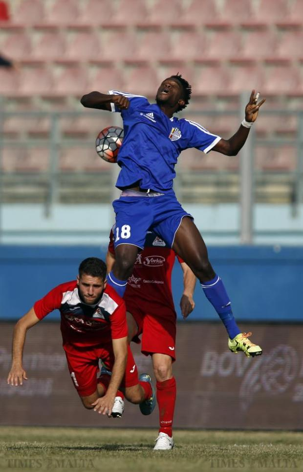 Pembroke's Siraj Arab (left) falls over during an aerial challenge with Mosta's Hassan Yau during their Premier League football match at the National Stadium in Ta'Qali on October 24. Photo: Darrin Zammit Lupi