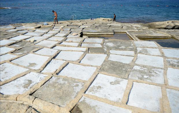 Two men swim near the saltpans in Marsacala on August 29. Photo: Matthew Mirabelli