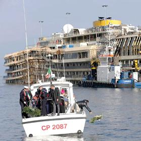 The Costa Concordia outside Giglio harbour. Thirty massive tanks filled with air will lift the hulk of the liner off the seabed in June so it can be towed away. Photo: Reuters