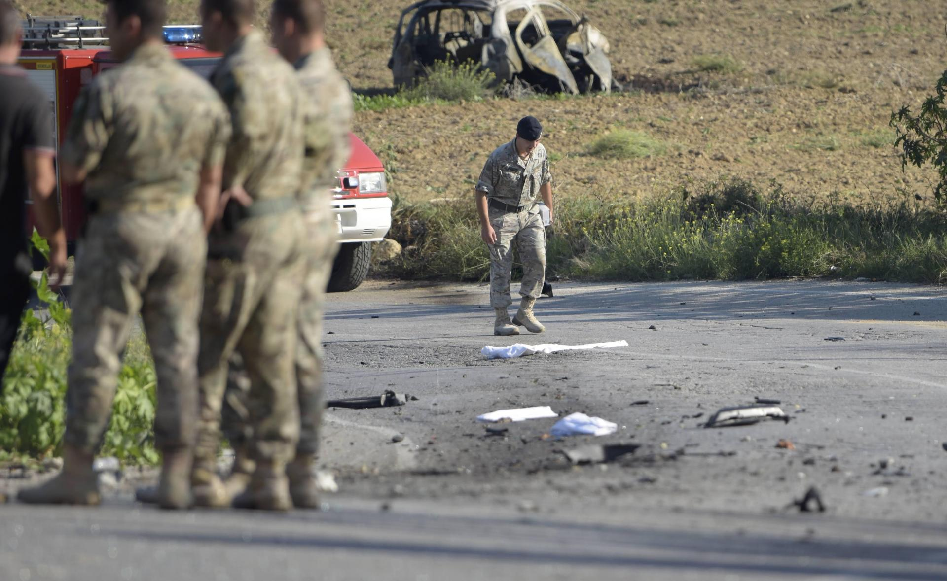 Debris lies on the ground at the site where Daphne Caruana Galizia's car was blown up in October 2017. Photo: Mark Zammit Cordina