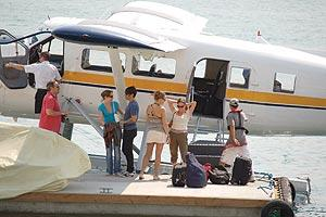 Kiedis (fourth from right) disembarking the Harbour Air Seaplane.