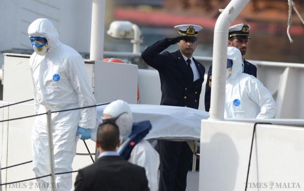 An Italian naval officer salutes one of the bodies as it is taken off the Coast Guard vessel Bruno Gregoretti at Boiler Wharf, Senglea in Malta April 20. Photo: Matthew Mirabelli