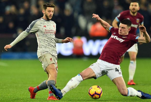 West Ham's Declan Rice (Right) attempts to block Liverpool's Adam Lallana.