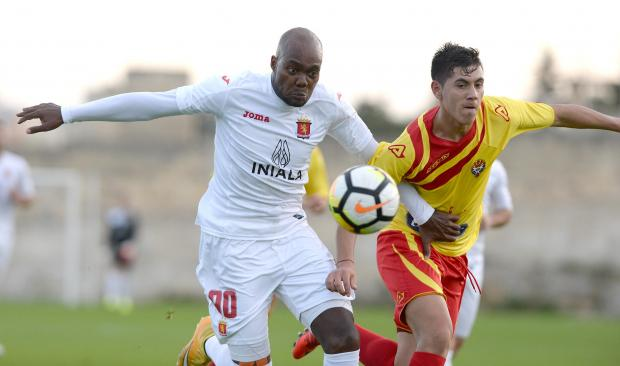 Valletta's Romeo Romao, (left) tries to makes his way past Senglea's Gonzalo Virano during their Premier league match at the Hibernian's Stadium in Paola on January 6. Photo: Matthew Mirabelli