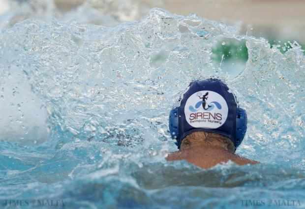 Water splashes over Sirens' Matthew Pisani during the waterpolo match against Marsaxlokk at the National Pool in Tal-Qroqq on June 18. Photo: Darrin Zammit Lupi