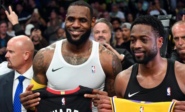 3cf0cecbcf10 Miami Heat guard Dwyane Wade (3) and Los Angeles Lakers forward LeBron James  (