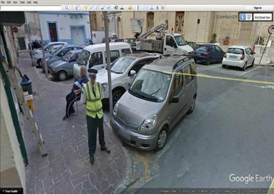 A warden does not seem too perturbed by this parking!