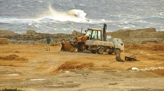 Heavy machinery at Dwejra, in an area where vehicles are prohibited. Sand used on the site was supposed to have been cleared up manually. Photo: Max Xuereb