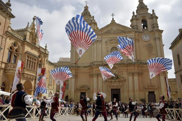 Flag bearers toss their flags in the air during the opening of the Medieval Mdina Festival on April 23. Photo: Mark Zammit Cordina