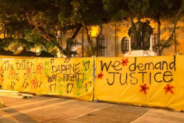 Graffiti sprayed onto the Valletta hoarding.