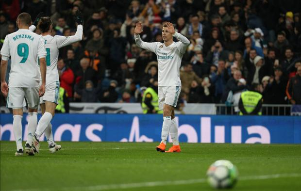 Real Madrid's Cristiano Ronaldo celebrates scoring their fifth goal to complete his hat-trick.