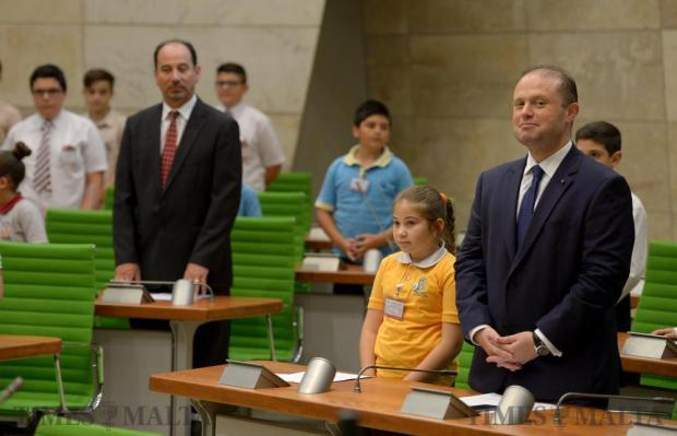 A young EkoSkola student and Prime Minister Joseph Muscat stand at the opening of a special sitting in Parliament to debate a motion moved by the students urging their older peers to take action on climate change on June 2. Photo: Matthew Mirabelli