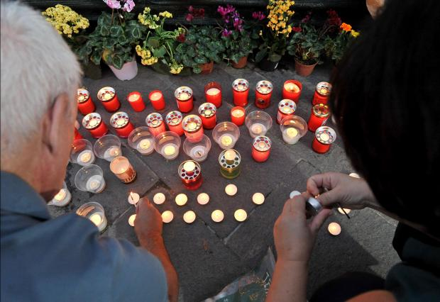 Candles and flowers laid at the monument are regularly removed. Photo: Chris Sant Fournier