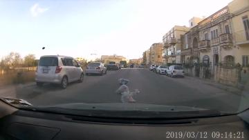 Gale-force winds leave Malta looking rubbish  | Bags of recycling ended up in the middle of residential roads.
