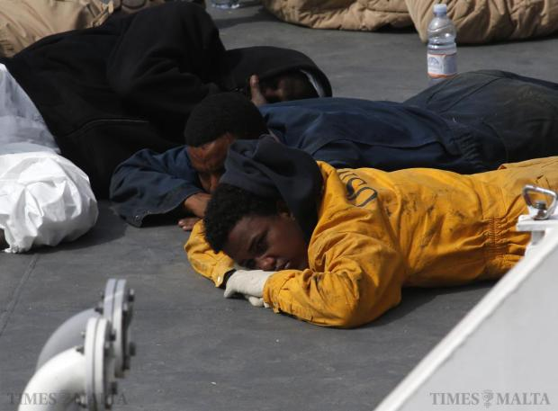 Surviving immigrants lie on the deck of the Italian coastguard ship 'Bruno Gregoretti' in Senglea on April 20. An Italian patrol ship arrived in Malta on Monday with 24 corpses recovered out of hundreds feared drowned after a migrant boat capsized in the Mediterranean, in one of the worst disasters yet in a growing humanitarian crisis. Photo: Darrin Zammit Lupi