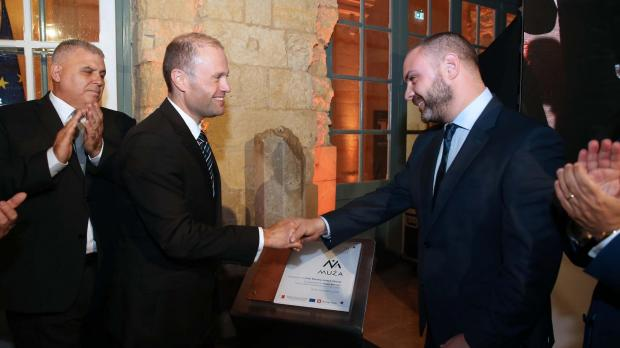 Dr Muscat shakes hands with Culture Minister Owen Bonnici, as Heritage Malta chairman Anton Refalo looks on. Photo: DOI/Kevin Abela